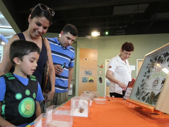 Christian Hayden, Monica Perez and Jay Hayden explore BugFest at River Bend Nature Center in 2015. The event returns to the center May 5.