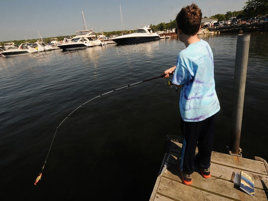 Anthony Bigari of Pewaukee casts off a pier in Fish