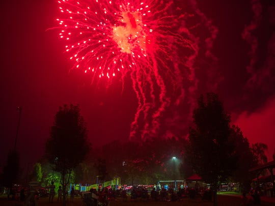 Smoke and fireworks fill the air during the Star Spangled