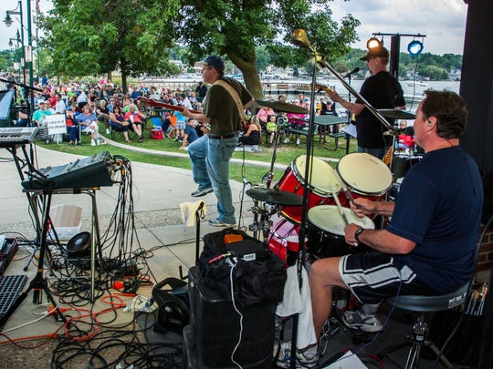A band performs for a crowd on the Pewaukee lakefront during the Waterfront Wednesdays concert series. The free concert series starts in June.