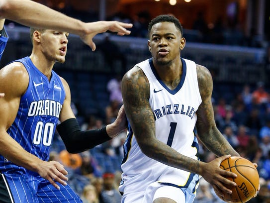 Memphis Grizzlies' Jarell Martin (right) drives the