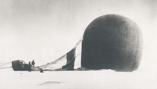 S.A. Andrée and Knut Frænkel with crashed balloon on the pack ice, photographed by Nils Strindberg, 1897.