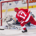 Red Wings survive Sabres in shootout win