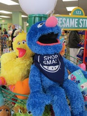 Big Bird and Grover encourage customers to shop small at The Toy Market in downtown Hammonton.