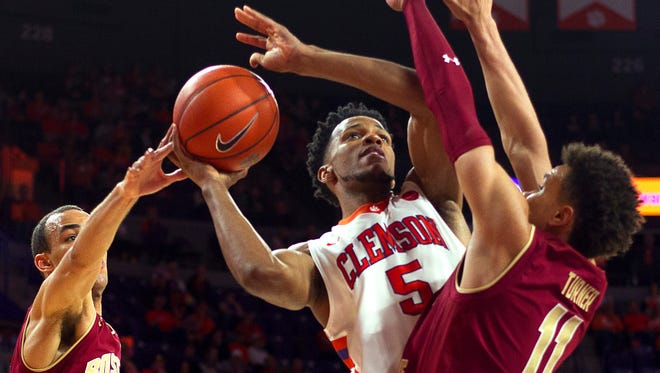 Clemson Tigers forward Jaron Blossomgame (5) attempts to go in for a layup while being defended by Boston College Eagles guard Jordan Chatman (25) and forward A.J. Turner (11) during the second half at Littlejohn Coliseum. Tigers won 82-68. Mandatory Credit: Joshua S. Kelly-USA TODAY Sports