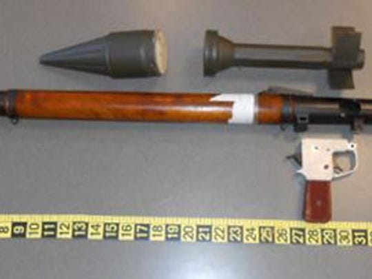 This photo provided by the Transportation Security Administration shows a defunct grenade launcher that TSA agents spotted in a passenger's checked bag at Lehigh Valley Airport in Allentown. The TSA says the unassembled parts of the launcher and a replica grenade were found on Monday, March 4, 2019, when an alarm went off as the bag passed through security equipment at the airport, about 60 miles north of Philadelphia.