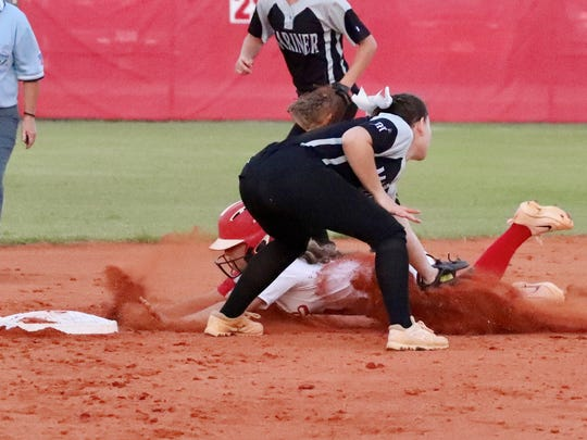 Mariner played North Fort Myers Thursday Night in  the District 6A-11 Final. North Fort Myers' Haley Weaver slides past the tag by Mariner's Erinn Pratt.