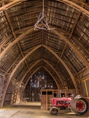 An old tractor in the Dempsey Wells Barn in the town of Wheatland.