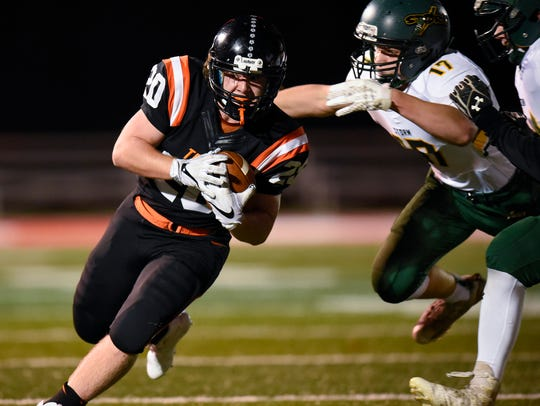 St. Cloud Tech running back Scott Kippley is tackled