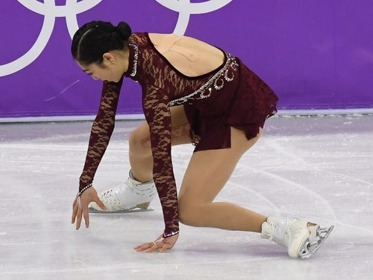 Mirai Nagasu starts to fall  in the ladies figure skating