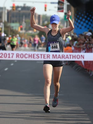 Brianna Deming, Morristown, NJ, crosses the tape as she takes first place in the marathon at the Rochester Marathon and Half Marathon held Sunday, Sept. 17, 2017 in Rochester.