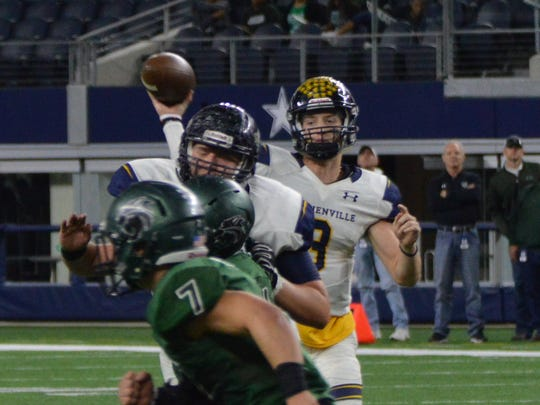 Stephenville's Easton Jones throws a pass with Kennedale's Ector Rivera (7) in the foreground providing coverage during KHS' 54-28 win over Stephenville in a Class 4A DI state semifinal at AT&T Stadium in Arlington on Fri., Dec. 15, 2017.