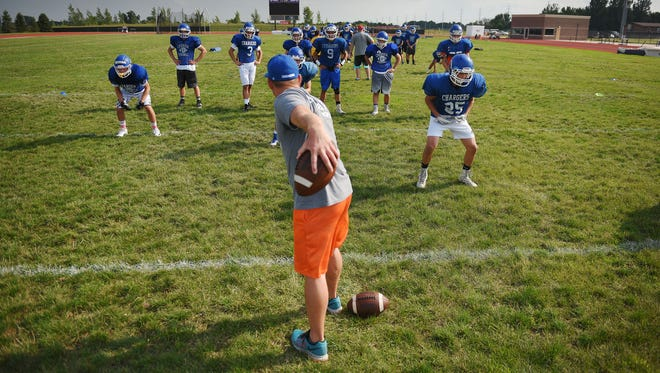 Sioux Falls Christian head coach Jake Pettengill practices with the team Wednesday, Aug. 9, 2017 at Bob Young Field in Sioux Falls.