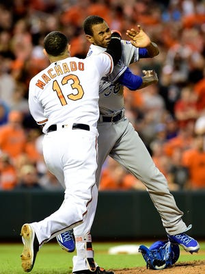 The Orioles' Manny Machado and Royals' Yordano Ventura fight in the fifth inning at Oriole Park at Camden Yards on Tuesday night.
