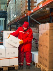 An employee at an XPO Logistics facility