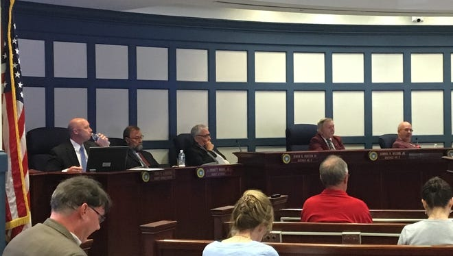 Members of the Sussex County Council introduced an ordinance Tuesday banning open carry firearms in county buildings. From left to right: Todd Lawson, J. Everett Moore, Irwin  Burton and Samuel Wilson.