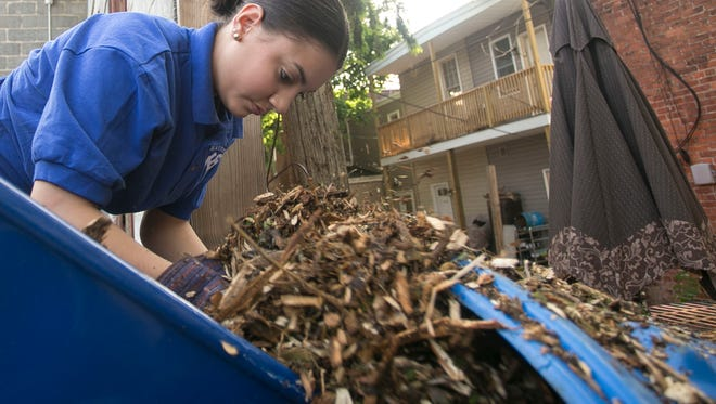 In this file photo, a Crispus Attucks Youthbuild Charter student works in the courtyard section of the Royal Square Community Garden Wednesday in May 2016.