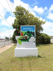 Dededo village sign.