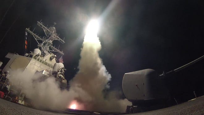 A handout photo made available by the US Navy Office of Information shows the guided-missile destroyer USS Porter (DDG 78) launching a missile strike while in the Mediterranean Sea, 07 April 2017. The United States military launched at least 50 tomahawk cruise missiles against al-Shayrat military airfield near Homs, Syria, in response to the Syrian military's alleged use of chemical weapons in an airstrike in a rebel held area in Idlib province on 04 April 2017.