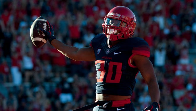 Oct 24, 2015: Arizona Wildcats wide receiver Johnny Jackson (30) celebrates after scoring a touchdown during the fourth quarter against the Washington State Cougars at Arizona Stadium. The Cougars won 45-42.