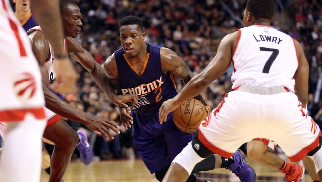 Nov 29, 2015: Phoenix Suns point guard Eric Bledsoe (2) goes to the basket as he is fouled by Toronto Raptors point guard Kyle Lowry (7) at Air Canada Centre.