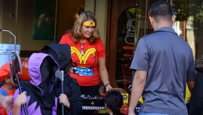 Trick-or-treaters walk up and down Palafox Street during the Downtown Trick or Treat in 2016.