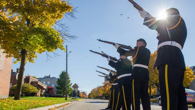 Members of the St. Clair County Allied Veterans Council Honor Guard fire their rifles during a Veteran's Day Ceremony at the American Legion Post 8 in Port Huron.