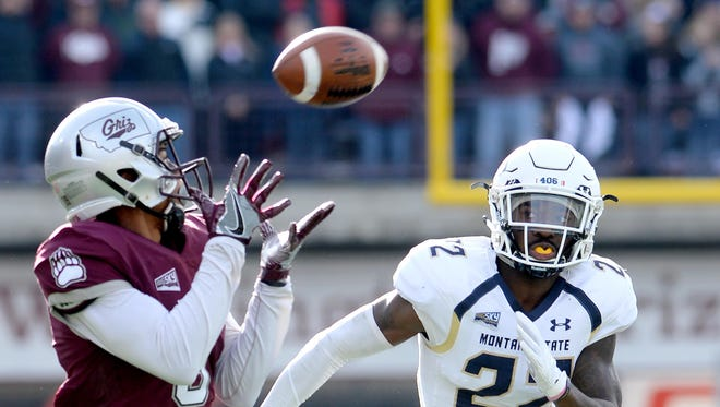 Montana receiver Justin Calhoun hauls in a touchdown pass against Montana State last year in Missoula. The two rivals meet for the 117th time Saturday afternoon in Bozeman.