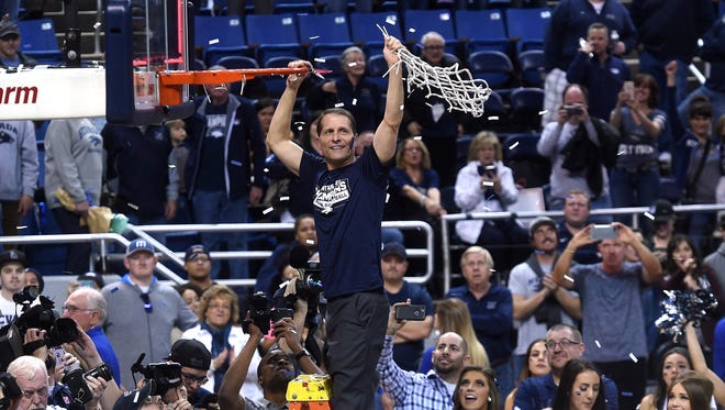 Nevada head coach Eric Musselman cuts down the net after defeating Colorado State to win the 2018 Mountain West regular-season championship.