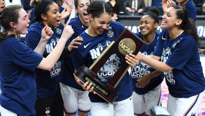Connecticut forward Gabby Williams reacts with teammates to being announced as the Most Valuable Player following the championship game of the Albany Regional of the 2018 NCAA Tournament.
