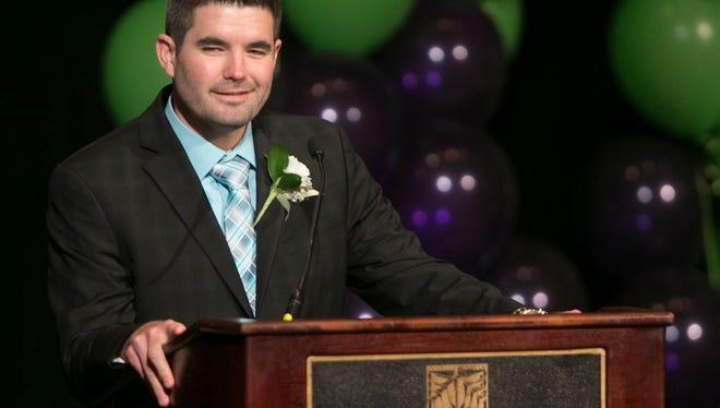 John-David Bowman of Westwood High School in Mesa accepts his Teacher of the Year award at the Arizona Biltmore in Phoenix, AZ on Nov. 20, 2014.