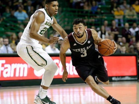 Baylor guard Al Freeman (25) defends against a drive to the basket by Texas A&M 's Alex Robinson (3) in the first half of an NCAA college basketball game, Tuesday, Dec. 9, 2014, in Waco, Texas. (AP Photo/Tony Gutierrez)