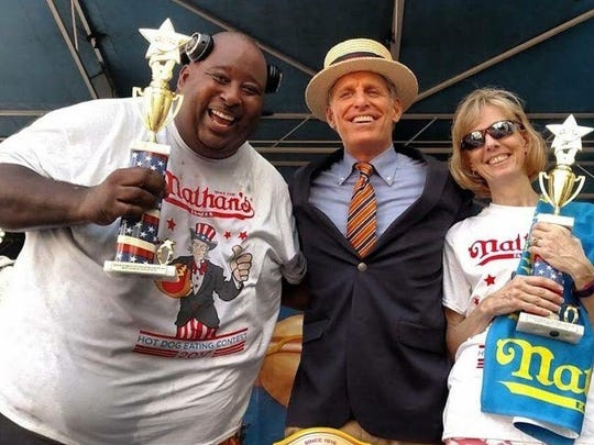 "Men's qualifier winner, Eric ""Badlands"" Booker and women's qualifier winner, Montville School District Superintendent Dr. René Rovtar, with Nathan's Famous Hot Dog Eating Contest Announcer George Shea, at the Charlotte, N.C., Nathan's Qualifier competition on May 27, 2017. Rovtar will compete against approximately 18 other women at the 100th Annual Nathan's Famous Fourth of July International Hot Dog-Eating Contest at Coney Island, in Brooklyn, N.Y. The finals are held at the original Nathan's Famous Hot Dog Restaurant on the corner of Surf and Stillwell Avenues, in Coney Island."