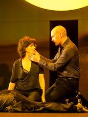 "Juliette Binoche (center) stars in ""Antigone."""