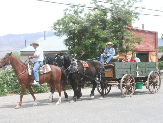 """A family enjoys a wagon ride during the """"Discover Gold in Dayton"""" held May 17 in Old Town Dayton."""