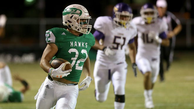 Wall's Tymber Carr scored on a 93-yard run on the Hawks' first offensive play Friday in their 64-13 win over Crane at Hawk Stadium in Wall, Oct. 20, 2017.