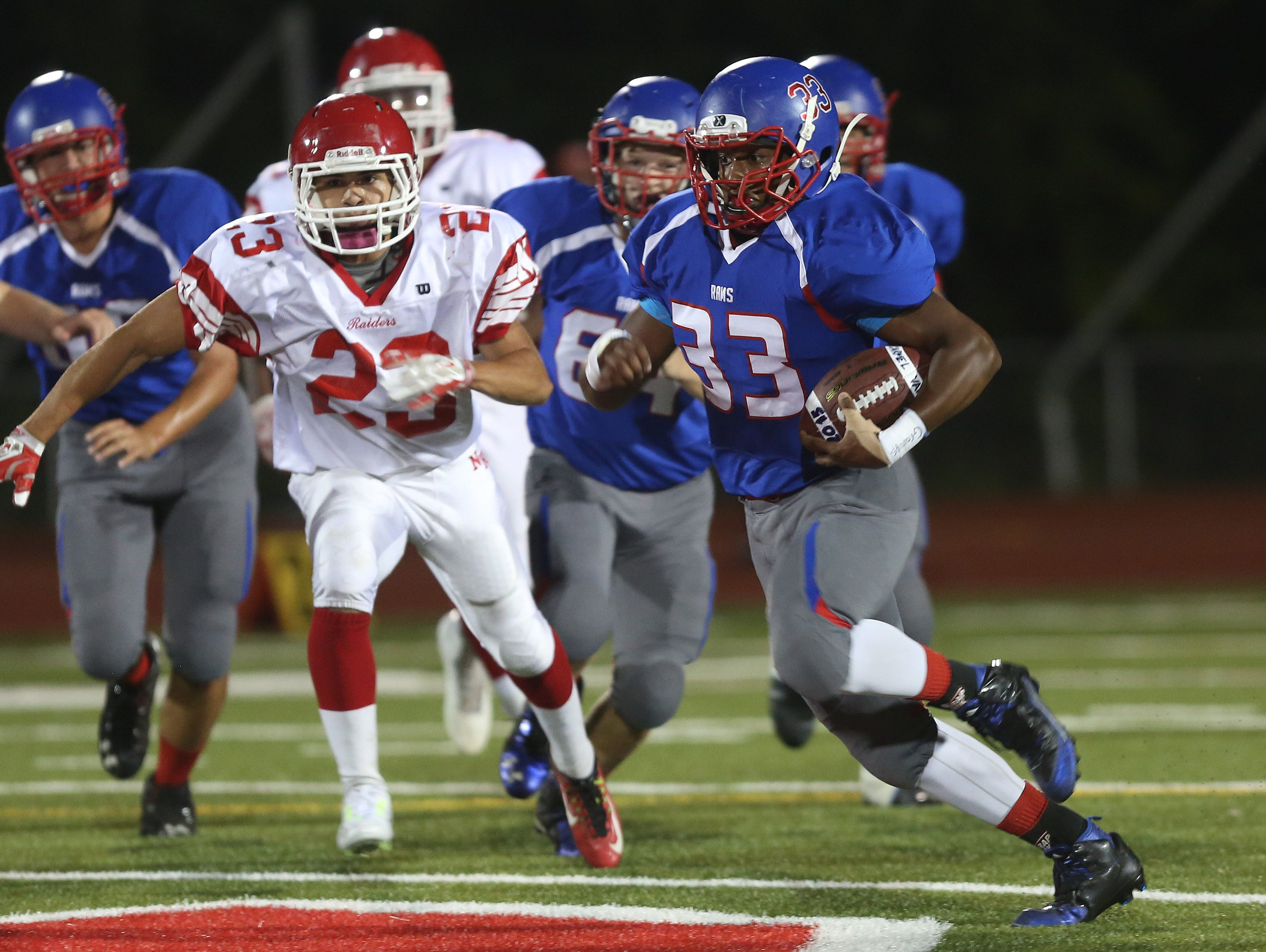Carmel's John Morris III (33) looks for some running room in the North Rockland defense during football action at Carmel High School Sept. 25, 2015
