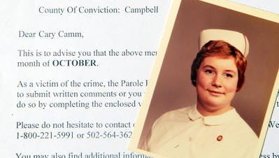 Diane Camm's photo lay atop a parole board notification hearing.
