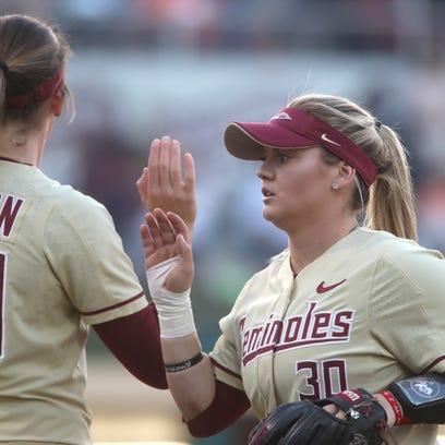 FSU's Jessie Warren high-fives teammates during their