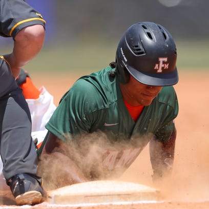 FAMU's Octavien Moyer slides safely into first base