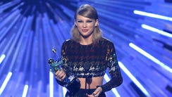 Taylor Swift accepts the award for female video of