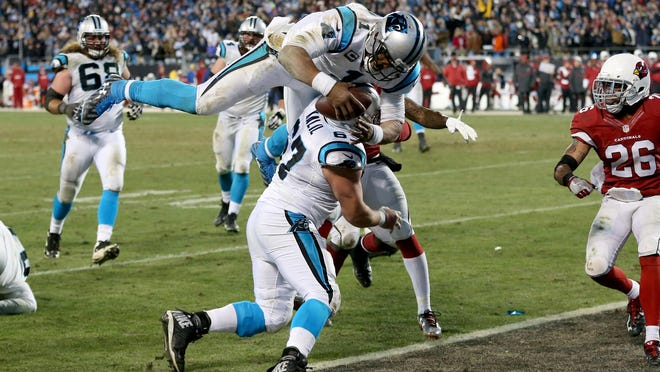 CHARLOTTE, NC - JANUARY 24: Cam Newton #1 of the Carolina Panthers scores a touchdown in the third quarter against the Arizona Cardinals during the NFC Championship Game at Bank of America Stadium on January 24, 2016 in Charlotte, North Carolina. (Photo by Streeter Lecka/Getty Images)