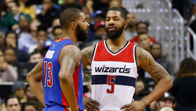 Marcus, left, and Markieff Morris and three others are accused of attacking a man outside a youth basketball tournament.