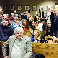 Neighbors raise hands to show they oppose the Great Life Ranch, a veterans' therapy facility in Bethpage that the Sumner County Board of Zoning Appeals denied on Thursday, Feb. 11. Pictured in the foreground is facility consultant Bill Williams.