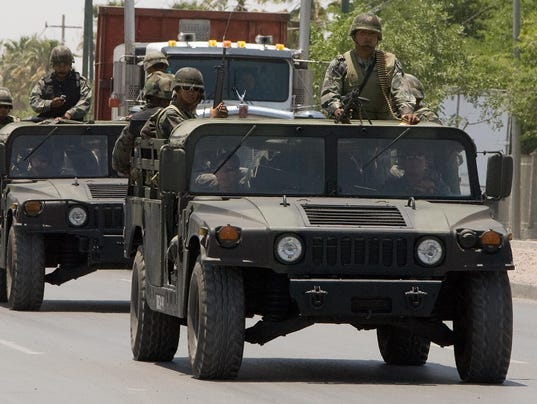 Mexican Army soldiers patrol the empty s