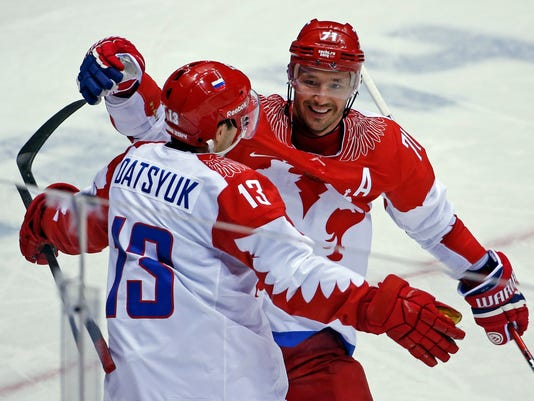 "FILE - This is a Saturday, Feb. 15, 2014 file photo of Russia forward Ilya Kovalchuk, right, as he  celebrates with forward Pavel Datsyuk after Datsyuk scored against the USA in the second period of a men's ice hockey game at the 2014 Winter Olympics in Sochi, Russia. Former NHL players Pavel Datsyuk and Ilya Kovalchuk will lead the hockey team of the ""Olympic Athletes from Russia"" at the Pyeongchang Games. It's the fifth Olympics for both Datsyuk and Kovalchuk. They will be on a team drawn entirely from the Russia-based Kontinental Hockey League. (AP Photo/Petr David Josek/File)"