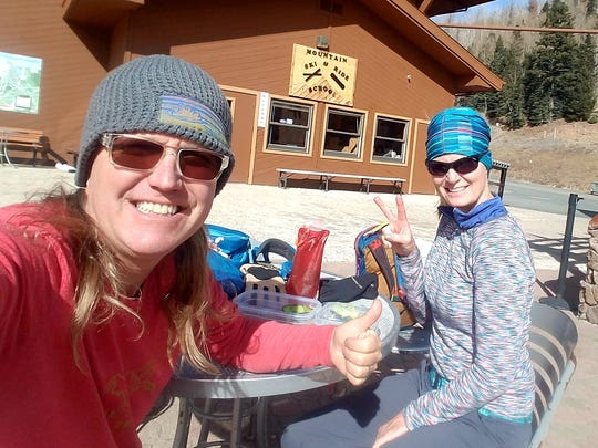 Rich and Anna Dozier have lunch at Ski Apache during their hike.