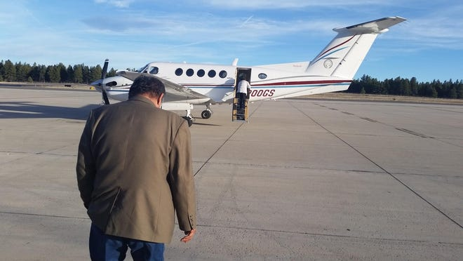 Former Navajo Nation President Ben Shelly and his wife, Martha Shelly, board a tribal plane in Flagstaff, Ariz. Tribal lawmakers have given the okay for a team to negotiate a $20 million loan to acquire three new planes, raising questions among tribal members about the priorities on the vast reservation.