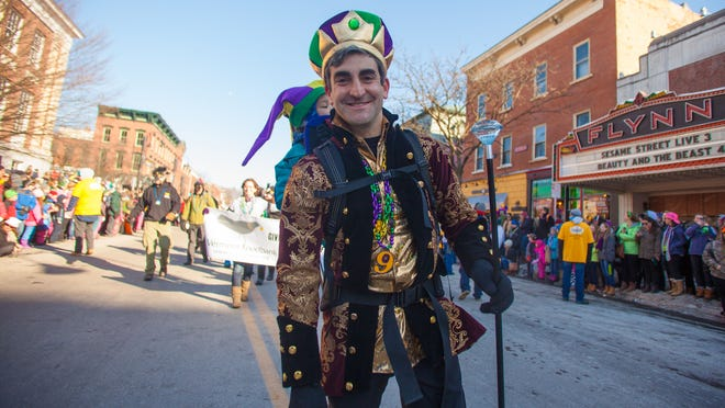 Burlington Mayor Miro Weinberger marches on Main Street for the Burlington Magic Hat Mardi Gras 2015 parade.