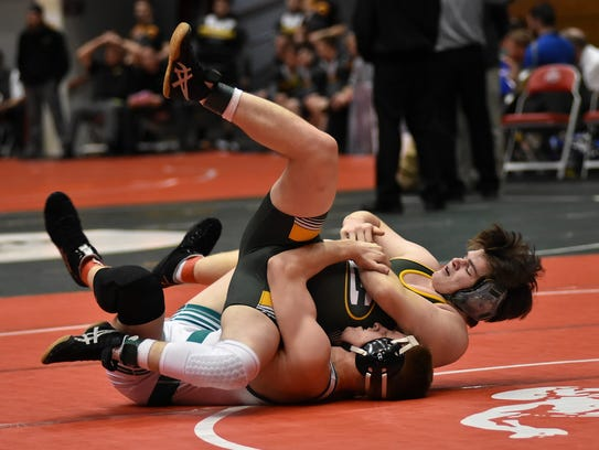 Eric Vermillion of Mason (bottom) rolls his Lakewood